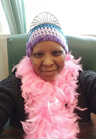 Me with my tiara and pink feather boa -FINAL day of chemo - 2.26.16
